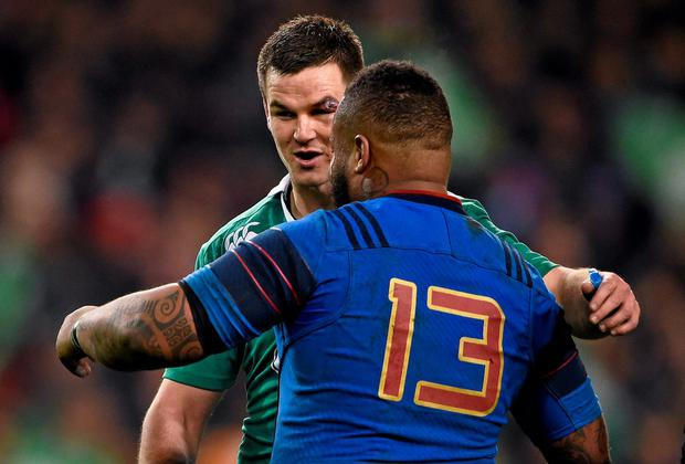Ireland's Jonathan Sexton with France's Mathieu Bastareaud after the game