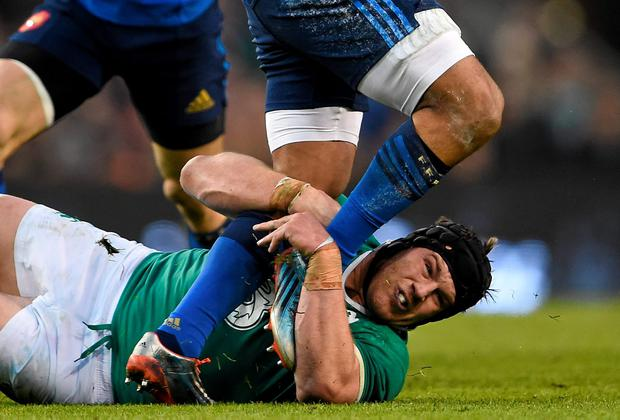Ireland's Sean O'Brien wraps his arms around the legs of France's Wesley Fofana during Saturday's Six Nations clash