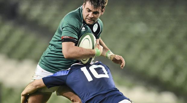 Ireland's Paul Pritchard is tackled by France's Julien Lavie