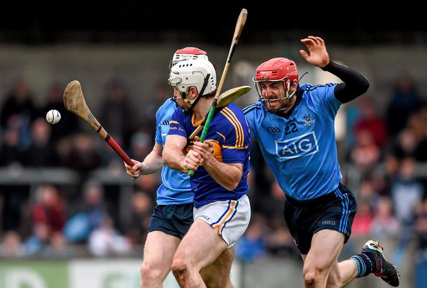 Gearoid Ryan, Tipperary, in action against Colin Cronin and Ryan O'Dwyer, right, Dublin