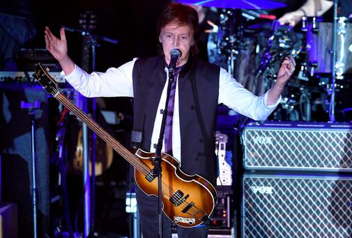 Paul McCartney greets the audience during his two-hour Valentine's weekend concert at New York City's Irving Plaza. Photo: Theo Wargo/Getty Images