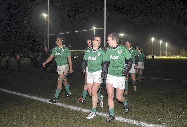Ireland players leave the pitch for the second time after floodlight failure.