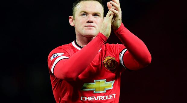 With Wayne Rooney failing to register a shot on target in 2015, Louis van Gaal has admitted that his captain is only a short-term solution to a long-standing midfield problem at Manchester United. Photo: Jamie McDonald/Getty Images