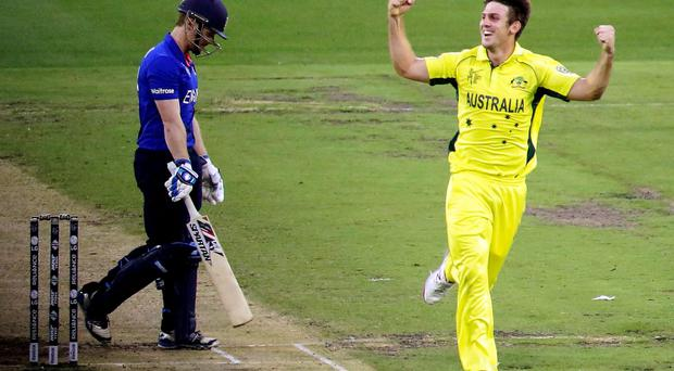 Australia's Mitchell Marsh celebrates dismissing England's captain Eoin Morgan