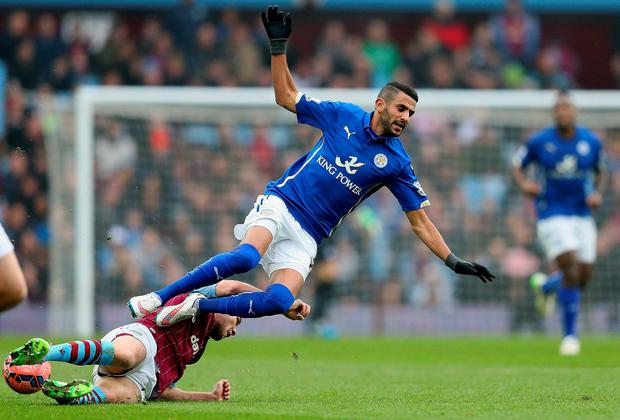 Riyad Mahrez of Leicester City is tackled by Villa's Ron Vlaar