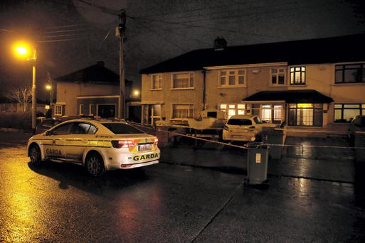Gardai investigate the shooting of a man in his sixties at a house on Harty Avenue in Walkinstown, Dublin. Picture: Arthur Carron
