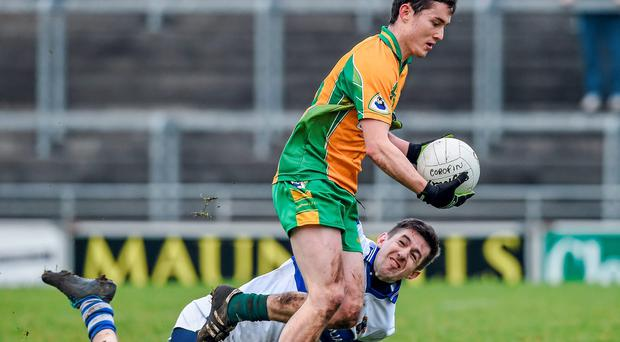 Ian Burke, Corofin, in action against Hugh Gill, St Vincent's