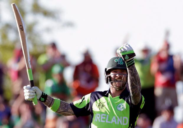 Ireland's John Mooney celebrates hitting the winning runs as they beat the West Indies for the first time in their Cricket World Cup match in Nelson, February 16, 2015. REUTERS/Anthony Phelps