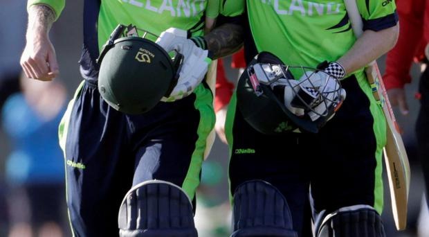 Ireland's John Mooney hugs teammate Niall O'Brien (R) after beating the West Indies for the first time in their Cricket World Cup match in Nelson, February 16, 2015. REUTERS/Anthony Phelps