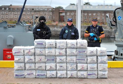 Members of the navy, customs and garda? pictured with the haul of cocaine seized on a yacht, Makayabella, in Haulbowline Naval base, Cork. Pic Michael Mac Sweeney/Provision
