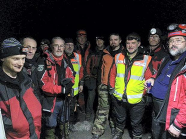 Members of South East Mountain Rescue express relief during an operational debrief after the safe rescue of a family of five, including three children, from the Knockmealdown Mountains.