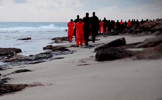 A still image from the video which claims to show the 21 men being led down a beach before being beheaded.