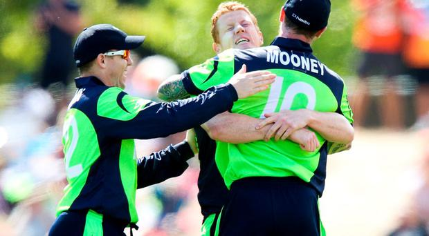 Ireland's Kevin O'Brien celebrates with teammates John Mooney and Niall O'Brien after taking the wicket of Dwayne Smith of the West Indies during the 2015 ICC Cricket World Cup match between the West Indies and Ireland