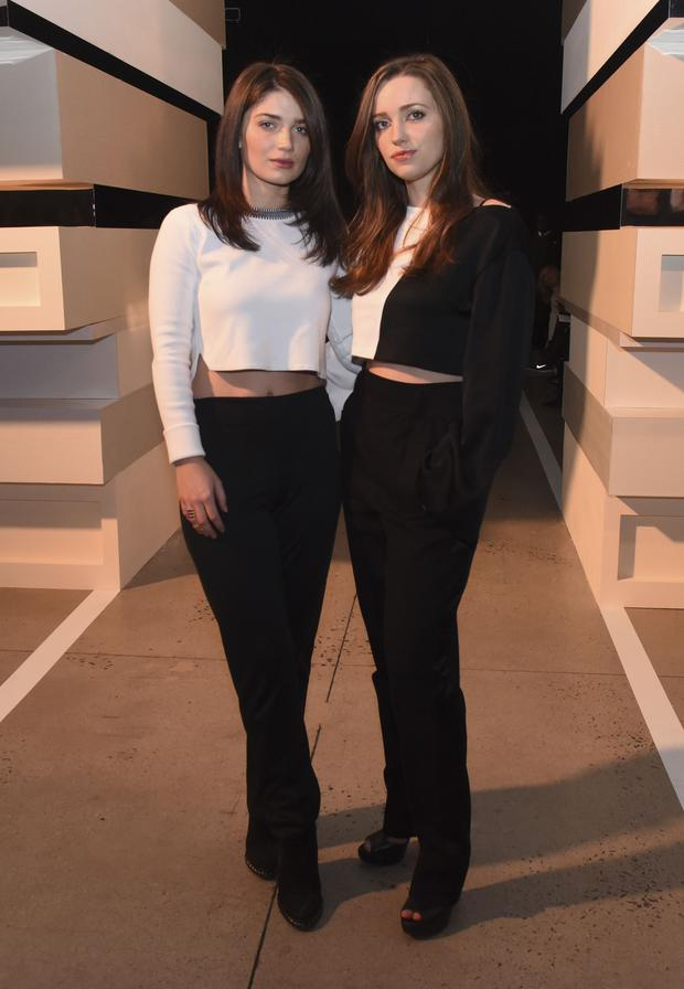 Eve Hewson and Jordan Hewson attend the Edun show during Mercedes-Benz Fashion Week Fall 2015 at Skylight Modern on February 15, 2015 in New York City.