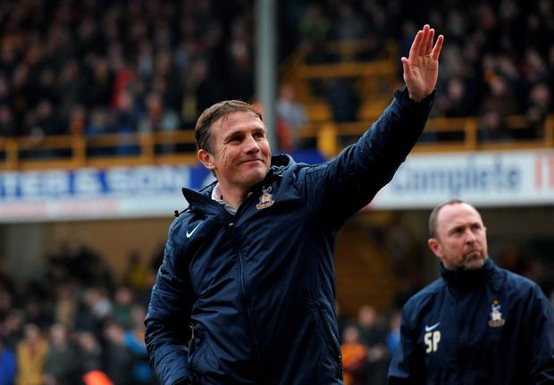 Bradford City manager Phil Parkinson waves at supporters during the FA Cup Fifth Round match at the Valley Parade, Bradford. Photo: Anna Gowthorpe/PA Wire.