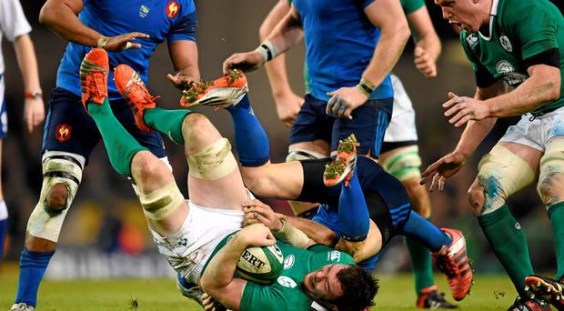 Peter O'Mahony, Ireland, is tackled by Rory Kockott, France. RBS Six Nations Rugby Championship, Ireland v France. Picture credit: Stephen McCarthy / SPORTSFILE