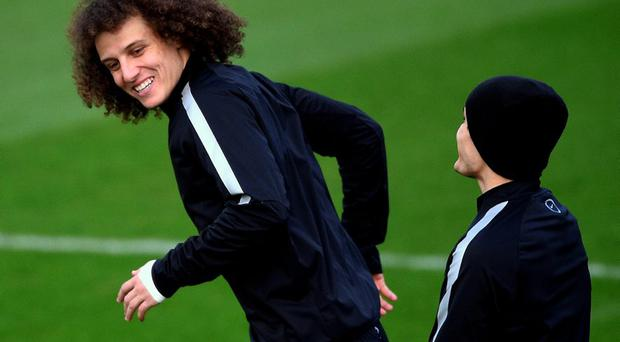 Paris Saint-Germain's Brazilian defender David Luiz (L) attends a training session in Saint-Germain-en-Laye, west of Paris, today