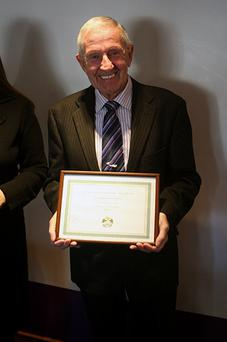 Ron Warren being honoured by the Ice Skating Association of Ireland for his outstanding contributions to the sport of figure skating in Ireland.
