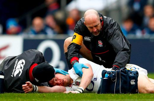 Mike Brown of England receives medical attention during the RBS Six Nations match between England and Italy at Twickenham Stadium in February