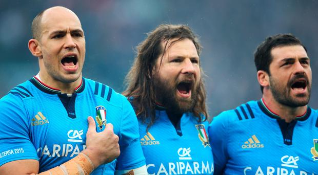 Sergio Parisse, Martin Castrogiovanni and Andrea Masi of Italy sing the national anthem during the RBS Six Nations match between England and Italy at Twickenham Stadium (Photo by Paul Gilham/Getty Images)