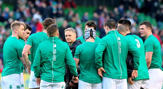 Joe Schmidt speaks with his players prior to Ireland's victory against France. Photo: Niall Carson/PA Wire
