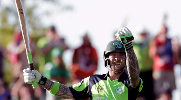 John Mooney celebrates after hitting the winning runs to seal victory for Ireland against the West Indies. Photo: REUTERS/Anthony Phelps