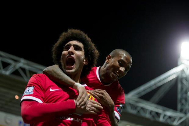 Manchester United's Marouane Fellaini, left, celebrates agoal for Manchester United