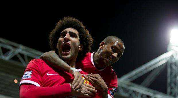 Manchester United's Marouane Fellaini, left, celebrates with teammate Ashley Young after scoring during the English FA Cup Fifth Round soccer match between Preston and Manchester United at Deepdale
