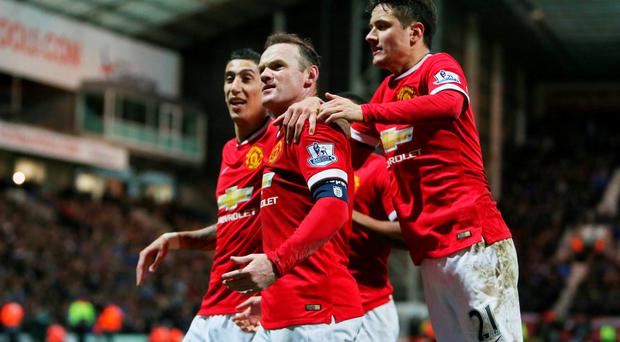 Manchester United's Wayne Rooney (C) celebrates scoring their third goal with Angel Di Maria and Ander Herrera (R