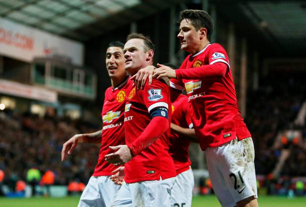 Wayne Rooney celebrates with Angel Di Maria and Ander Herrera after scoring Manchester United's third goal in their FA Cup fifth-round clash at Deepdale. Photo: Action Images via Reuters / Carl Recine