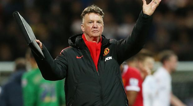 Manchester United manager Louis van Gaal applauds their fans as he celebrates at full time