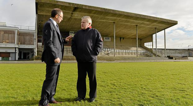 Republic of Ireland manager Martin O'Neill in conversation with George Lee, project manager of the Limerick Enterprise Development Partnership, during a visit to the Markets Field Project