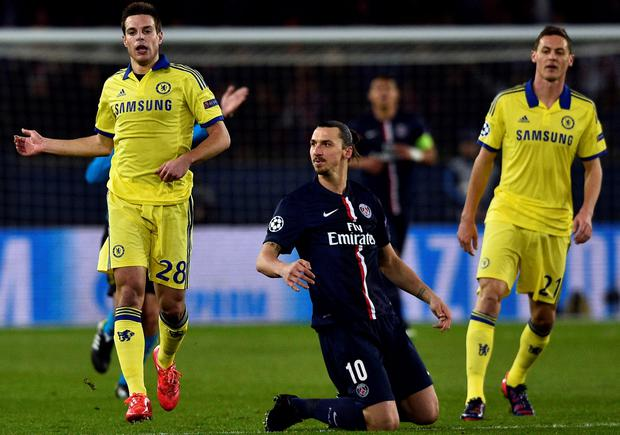 Paris Saint-Germain's Swedish midfielder Zlatan Ibrahimovic (C) reacts after missing a goal opportunity during the UEFA Champions League