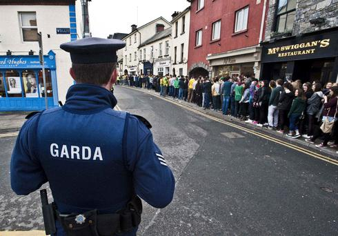 Keeping a close eye on the students lining up on Eyre Street in Galway City for 'Donegal Tuesday'