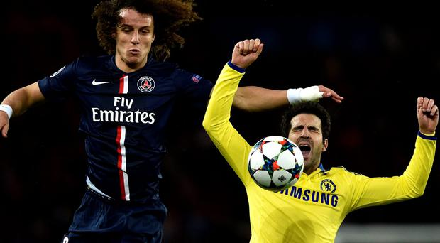 Paris Saint-Germain defender David Luiz challenges Chelsea's Cesc Fabregas during their Champions League round-of-16 clash at the Parc des Princes. Photo: AFP PHOTO / FRANCK FIFEFRANCK FIFE/AFP/Getty Images