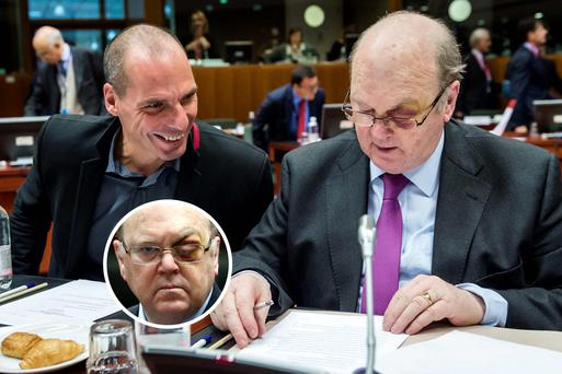 Michael Noonan with Greece's Yanis Varoufakis at an EU finance ministers meeting yesterday. Inset, the swelling and bruising around Mr Noonan's left eye.