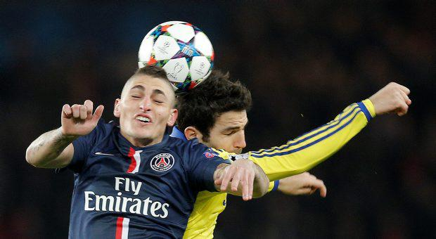 PSG's Marco Verratti, left, and Chelsea's Cesc Fabregas battle for the ball during the Champions League round of 16 first leg soccer match between Paris Saint Germain and Chelsea at the Parc des Princes stadium in Paris, France, Tuesday, Feb. 17, 2015. (AP Photo/Christophe Ena)