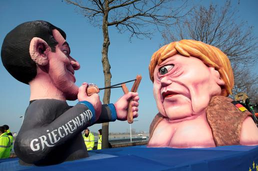A carnival float with papier-mache caricatures of German Chancellor Angela Merkel (R) and a figure representing Greece (L) takes part in the traditional Rose Monday carnival parade in the western German city of Duesseldorf February 16, 2015. The Rose Monday parades in Cologne, Mainz and Duesseldorf are the highlight of the German street carnival season. REUTERS/Ina Fassbender