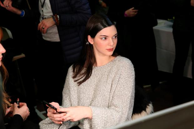 Kendall Jenner prepares backstage at the Donna Karan New York fashion show during Mercedes-Benz Fashion Week Fall 2015