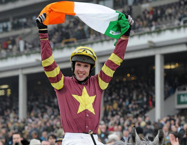 Jockey Derek O'Connor celebrates winning the141st Year Of The National Hunt Chase Challenge Cup, on Chicago Grey in 2011