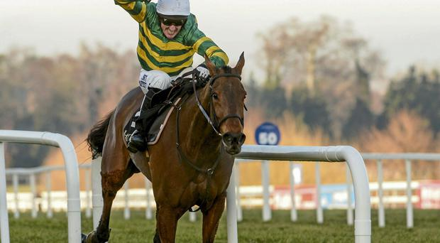 Carlingford Lough, with Tony McCoy up, cross the finish line to win the Hennessy Gold Cup. Leopardstown, Co. Dublin