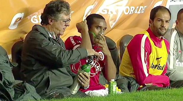 Out of breath: Anderson requires an oxygen mask after being substituted