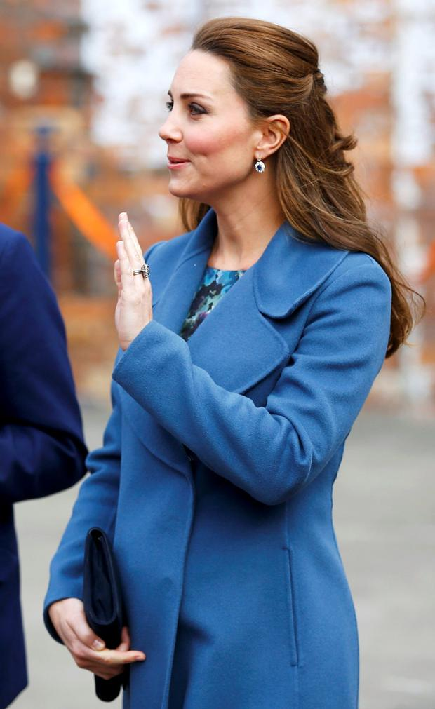Britain's Catherine, Duchess of Cambridge, waves a she leaves after visiting the Emma Bridgwater factory in Stoke-on-Trent