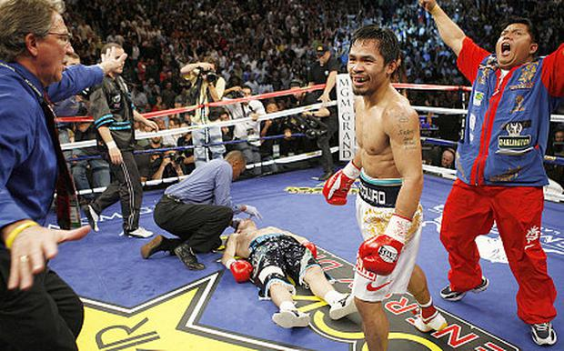 Hatton lies on the canvas after defeat to Manny Pacquiao. Source: REUTERS