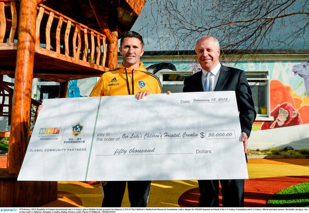 18 February 2015; Republic of Ireland international and LA Galaxy player Robbie Keane presents Joe Quinsey, CEO of The Children's Medical and Research Foundation, with a cheque for $50,000 donated on behalf of the LA Galaxy Foundation and LA Galaxy official nutrition sponsor Herbalife, during a visit to Our Lady's Children's Hospital, Crumlin, Dublin. Picture credit: Piaras ? M?dheach / SPORTSFILE