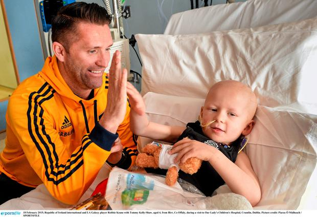 18 February 2015; Republic of Ireland international and LA Galaxy player Robbie Keane with Tommy Kelly-Shaw, aged 4, from Birr, Co Offaly, during a visit to Our Lady's Children's Hospital, Crumlin, Dublin. Picture credit: Piaras ? M?dheach / SPORTSFILE