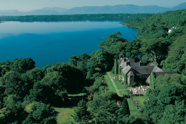 An aerial view of Ard Na Sidhe, which translates as 'Hill of the Fairies'. The Arts & Crafts-style country house hotel is located just outside Killorglin, Co. Kerry.