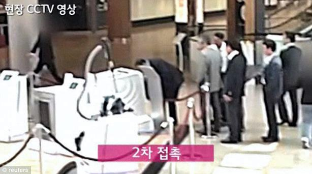 A grab from a video released by LG of their executives looking at the Samsung washing machine in a store in Berlin