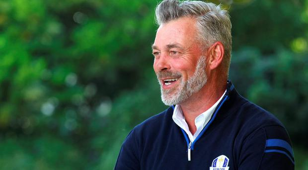 Darren Clarke shows his delight at the news that he will captain Europe in the 2016 Ryder Cup at Hazeltine. Photo: Luke Walker/Sunshine Tour/Gallo Images/Getty Images