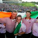 Darren Clarke celebrates with Paul McGinley and Padraig Harrington after Europe's Ryder Cup at The K Club in 2006 in Straffan. Photo: David Cannon/Getty Images